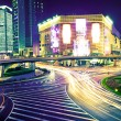 The light trails on the modern building background — 图库照片 #16178031