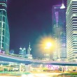 The light trails on the modern building background — 图库照片