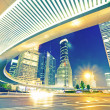 The light trails on the modern building background — 图库照片 #16178677
