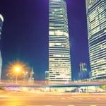het licht paden op de modern gebouw achtergrond — Stockfoto #16178733