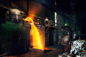Pouring of liquid metal in open hearth workshop — Stock Photo