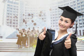 Asian graduate with big thumb — Stock Photo