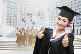 Asian graduate with big thumb — Stock Photo