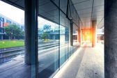 Empty long corridor in the modern office building — Stock Photo