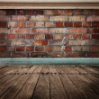 Brick wall with wooden floor — Stock Photo