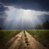 Rural road and the god ray — Stock Photo