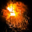 Stock Photo: Pouring of liquid metal in open hearth workshop