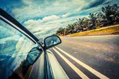 Speed car driving at high speed on empty road - motion blur — Stock Photo