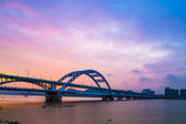 Night bridge with sunset — Stock Photo