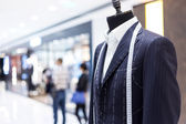 Suits on shop mannequins — Stock Photo