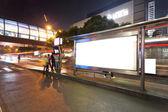Blank billboard on bus stop at night — Stock Photo