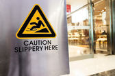 Caution sign at store — Stock Photo