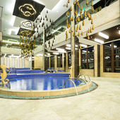 Luxury swimming pools in a modern hotel — Stock Photo
