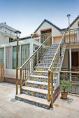 Backyard house entrance, stairs with ceramic tiles — Stockfoto