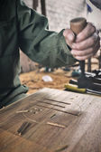 Worker carving wood — Stock Photo