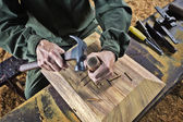 Worker carving wood — Stockfoto
