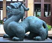 Antique Chinese mythological animal made of stone — Stock Photo