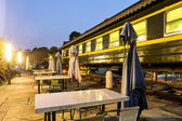 Outdoor cafe bar with an old train background — Stock Photo