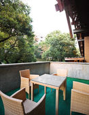 Large terrace with dining table and chairs — Stock fotografie