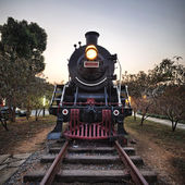 Vintage Steam Engine train with sunset — Stock Photo