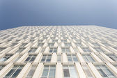 Part of modern business building against blue sky — Stock Photo