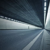 The tunnel at night, the lights formed a line. — Stock Photo