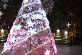 Christmas tree at night, in plaza — Stock Photo