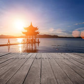 Ancient pavilion in hangzhou with sunset glow — Stock Photo