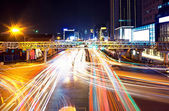 The light trails on the modern building background — Stock Photo