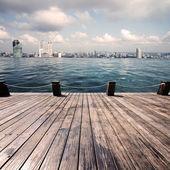 Swimming pool and scene of city — Stock Photo