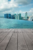 Swimming pool and scene of city — Stock Photo