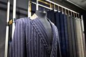 Suits on shop mannequins  — Stock Photo