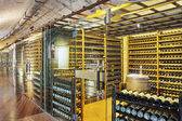 Wine cellar with wine bottle and glasses  — Stock Photo