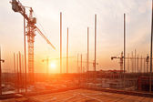 Buildings under construction with sunset — Stock Photo