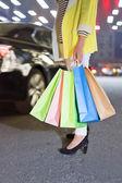 Photo of young joyful woman with shopping bags  — Stock Photo