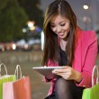 Happy woman shopping and using tablet PC — Stock Photo #46389427
