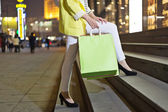 Happy woman shopping and holding bags girl — Stock Photo