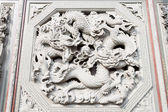 Facade of a stone carving of a dragon  — Foto Stock
