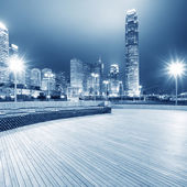 Square with night modern building background — Stock Photo