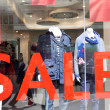 Sale Sign In A Clothing Store Window — Stock Photo #47875597