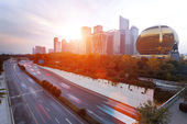 Modern city with sunset — Stock Photo
