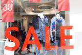 Sale Sign In A Clothing Store Window — Stock Photo