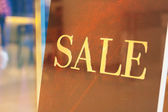 """Lettering """"sale"""" in the shop — Stock Photo"""