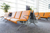 Modern airport terminal waiting room — Stock Photo