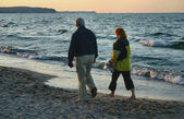 Evening beach stroll — Stock Photo