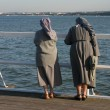 Nuns on pier - Stock Photo