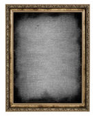 Golden frame with empty canvas — Stock Photo