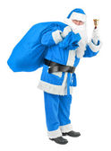Blue Santa claus with bell on white — Stock Photo