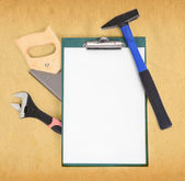 Work tools and clipboard — Stock Photo
