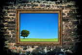 Golden wooden frame with beautiful landscape — Stock Photo